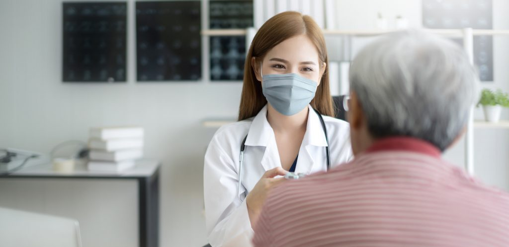 Woman doctor seeing a patient